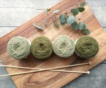green yarn on cutting board